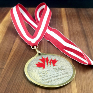 Custom designed gold metal medallion with inlaid red IBC/BAC logo. and red/white Ribbon. Cast by a Canadian foundry.