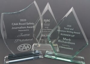Clear glass corporate trophies with laser engraved winner and event info.