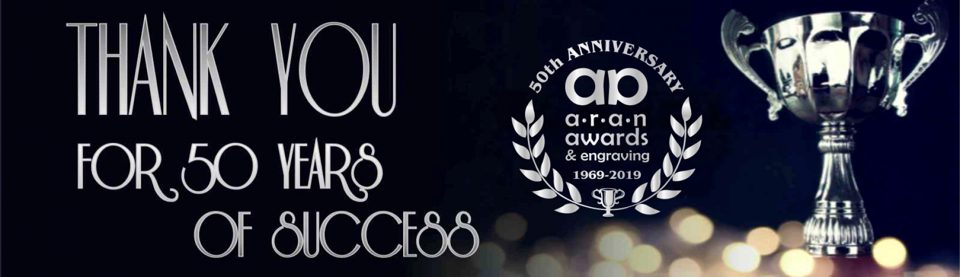 Banner image celebrating 50 years of business. Black background with silver trophy and Aran Awards logo.