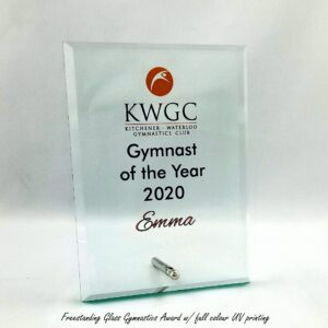 Free standing glass plaque with silver support post and uv printed awards winners.